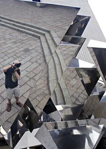 Self-portrait in sculpture in front of RJR building