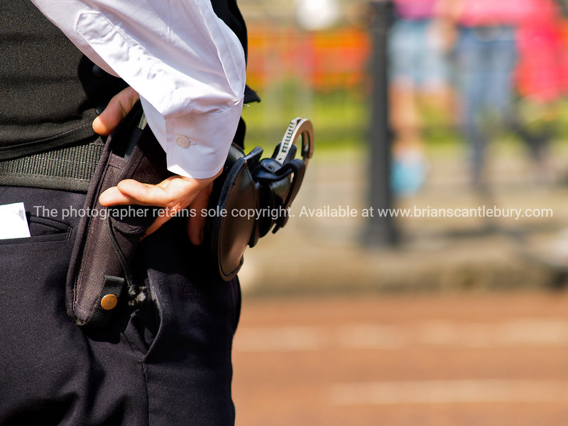 Police hand and weapons, close up.