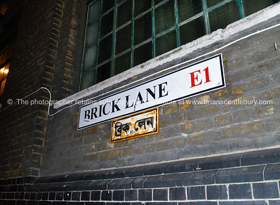 Brick Lane, road sign, London, England, Britain, United Kingdom with arabic interpretation below..