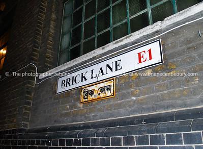Brick Lane, road sign, London, England, Britain, United Kingdom with arabic interpretation below..