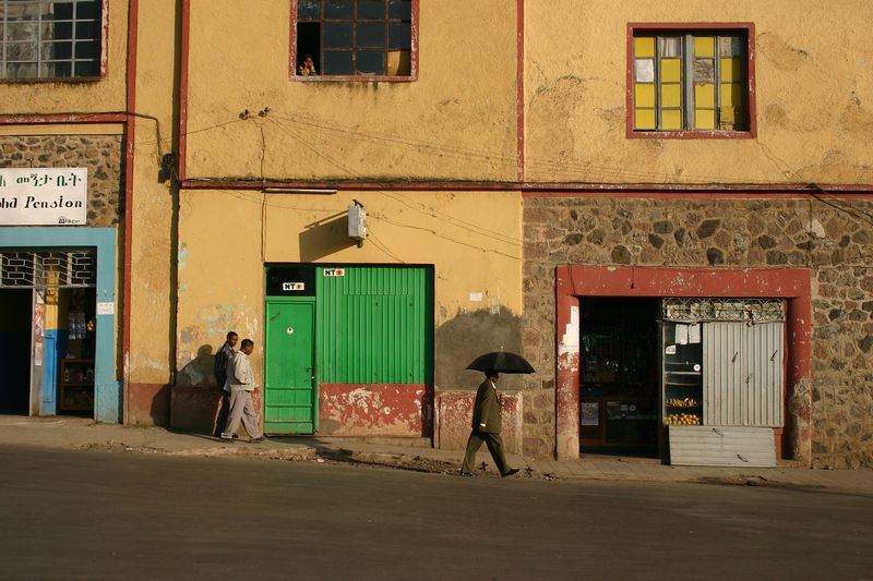 man with umbrella, gondar, ethiopia