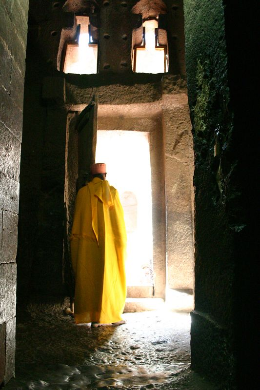 priest in yellow robe, lalibela, ethiopia