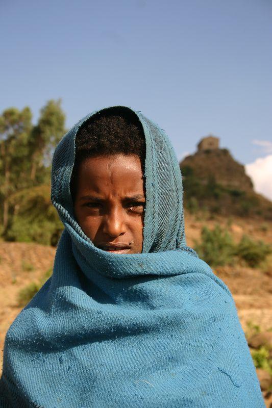 shepherd girl on the path to pantaleon monastery, axum, ethiopia