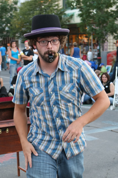 A street performer is startled by having his picture taken.