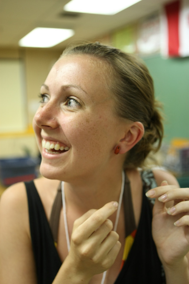 A volunteer adjusts her earring before her shift.