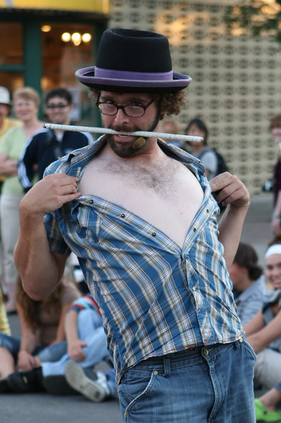 A street performer shows his chest.