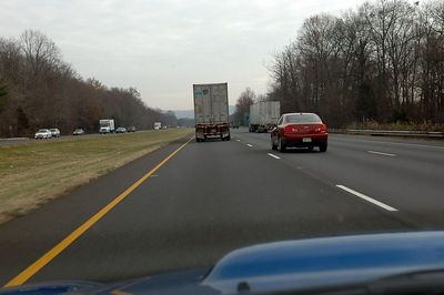 Perhaps the driver of this truck doesn't read english or simply ignores the signs that state No Trucks in Left Lane
