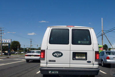 NJ State Gov't vehicle on a weekend.  And driving like an idiot at that!