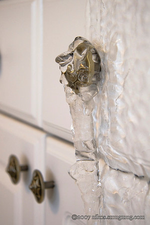 Kitchen drawer knob encased in ice.