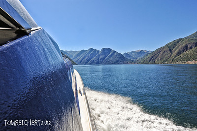 LAKE COMO - HANGING OFF THE SIDE OFF BOAT