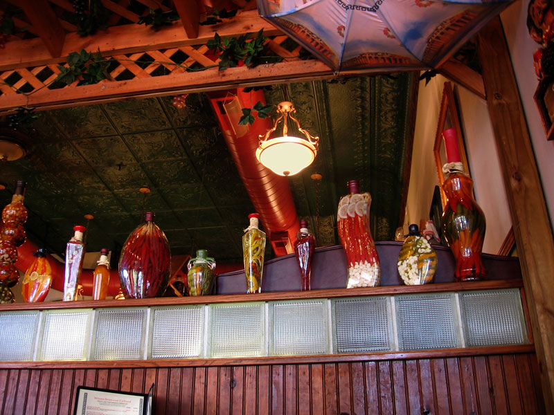 Some interesting bottles at the Mad Greek restaurant.<br /> The old tin ceiling tiles are visible in this shot.