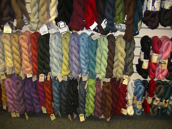 This alpaca yarn at the Yarn Barn is fairly expensive.<br /> We once toyed with the idea of buying our own alpacas when were at a fiber festival in Colorado...<br /> the rancher trying to sell them to us said we could <br /> just take out the backseat of our car<br /> and easily transport them home.<br /> But we decided our neighbors may not like us keeping alpacas in the backyard...<br /> ...we are very sophisticated urbanites here.<br /> <br /> Although, I am reminded that there is a llama farm nearby.<br /> Becky raised the window shade one morning to find the backyard full of llamas.<br /> Not knowing what else to do, she called 911 and told them her backyard was full of llamas.<br /> They acted like she was nuts.