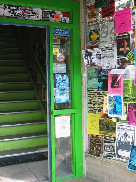 "I call this photo ""The Green Door"".<br /> I don't know what this place is, it just looks interesting with all the flyers stuck to the wall...<br /> I'm sure its too hip for me.<br /> I think most of these adverts are for bands."