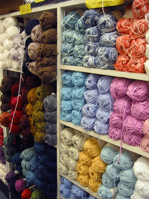 The proprieters of the Yarn Barn<br /> were kind enough to let me wander around and take pictures<br /> while Becky shopped for yarn and looked through weaving magazines and books.<br /> I thought this display of colorful yarn looked too neat<br /> and I was tempted to mess it up a bit for visual interest...<br /> ...but I noticed some customers were looking out the corner of their eye at me... and I decided better of it.