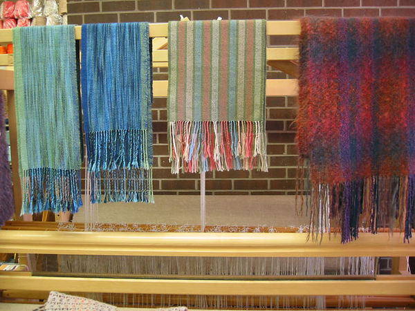 This loom and weavings were set up next to the front door of the Yarn Barn and are some of the first things you see when entering the store.<br /> The loom is a counter-marche.