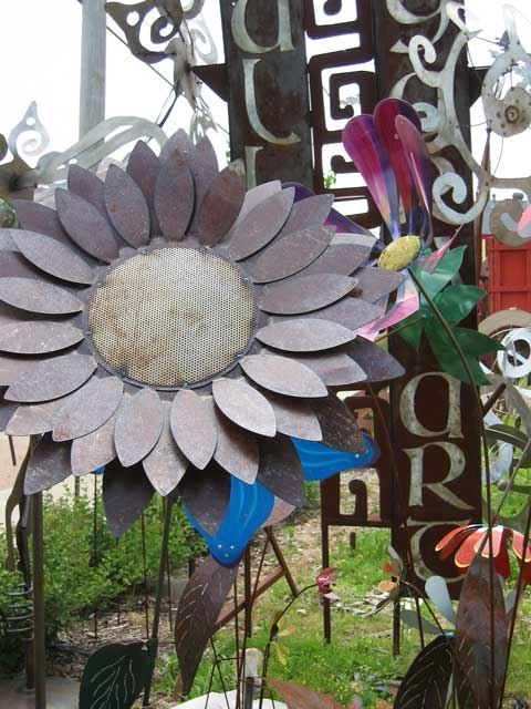 Some of the metal sculptures set out by the street enticing passers-by to stop and browse.