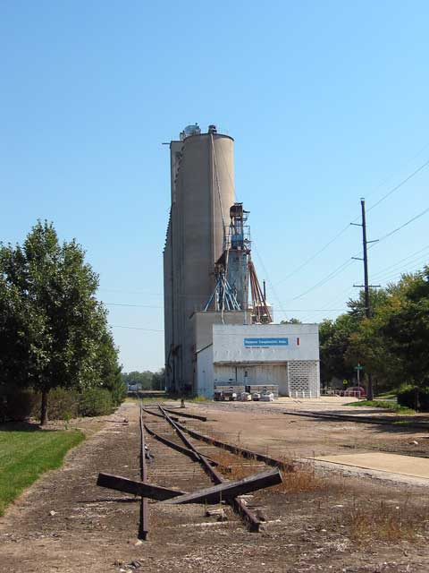 This grain elevator is next to the Lawrence Visitor Center.<br /> I just thought the tracks receding into the distance and the tall silo made for an interesting picture.<br /> Across the street from here to the south is the Kansas River.<br /> In the winter you can see some bald eagles there.