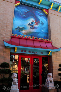Dragon House ~ A design group is housed in this building with the magnificent dragon painting.  Outside the door is a pool and fountain with sculptures.