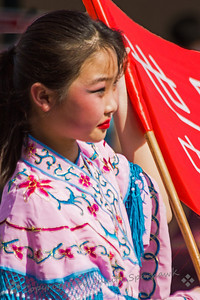 Girl with the Flag ~ This pretty girl was part of the parade last Saturday, for the Lunar New Year celebration in LA's Chinatown.