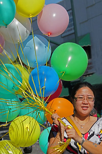 The Baloon Lady ~ The woman walked by sporting all these balloons--it was fun and colorful.