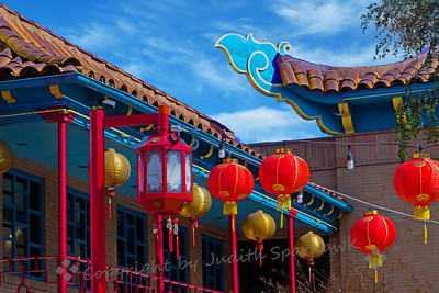 Central Plaza Scene ~ Los Angeles Chinatown's Central Plaza is filled with buildings of Chinese archtectural details, lanterns, merchandise.  This is one view of the plaza.