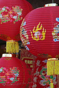 Red Lanterns ~ The shops along the streets of Chinatown had many red and gold decorations for sale for the New Year.  These red lanterns caught my eye as I walked by.