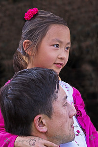 At the Parade ~ This beautiful little girl was sitting on her father's shoulder, an onlooker at the Chinese Lunar Parade today.  I liked her pretty face and the closeness shown between father and daughter.