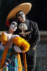 Couple at Dia de los Muertos ~ In celebration of the Day of the Dead there was continuing entertainment, including Aztec Dancers, Mariachi Bands, Singers, and a variety of musical play enactments.  This engaging couple was in one of the plays.