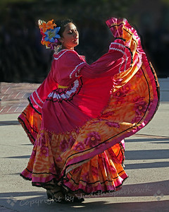 Dancing Beauty ~ One of the dance group performing Mexican dances in the pavillion at Olvera Street, Los Angeles, California.