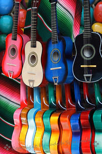 Crazy For Color ~ I have always been attracted to the brightly colored guitars for sale at the vendors along Olvera Street.  I have photographed them several times; occasionally they are displayed in a pleasing arrangement that just begs a picture.