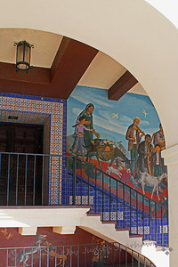 Through the Arch ~ The mural is part of one showing the Blessing the Animals, on an Olvera Street building. I liked the combination of arches, rafters, stairway.