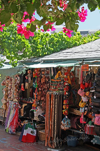 Olvera Street Marketplace ~ This is just one of the many vendor booths set up along the street, offering toys, clothes, leather, and various novelty items.