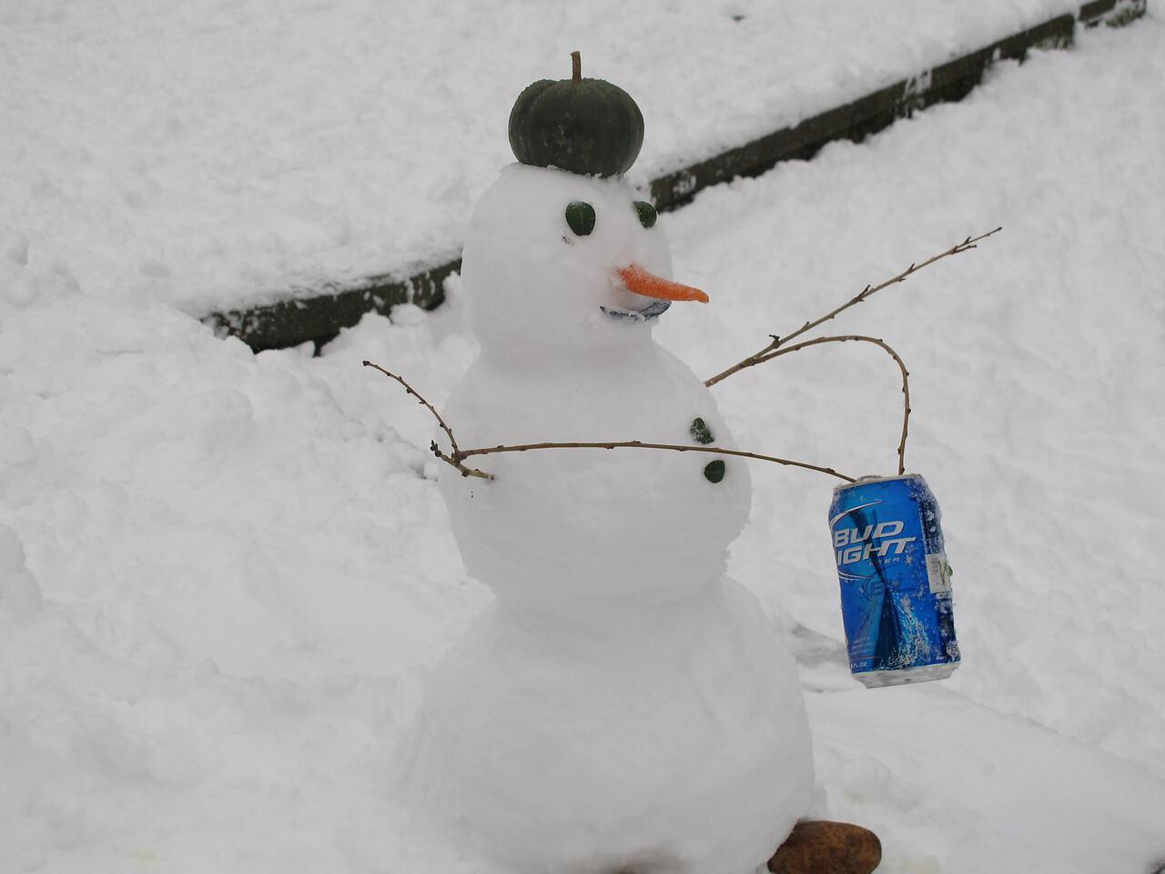 Beer drinking snow penguin.
