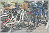 a view of bikes at a city art festival; this image has been manipulated to make it look like a silkscreen fine art print