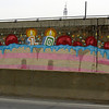 10th Birthday Cake?? <br /> Seen daily on my commute home from the ramp down from the Ville Marie Expressway into the Turcot Yard. This is an amazing piece of work that has been there for years. I have wanted to photograph it for ages but haven't had the chance until this weekend when I was a passenger with my son James driving. I managed to squeeze off 2 shots. Unfortunately, the concrete barrier obscures the bottom half of it.