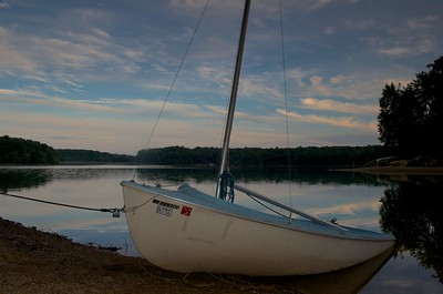 Sailboat in Triadelphia Reservoir against skyline with ND filter