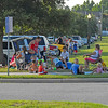Festival goers find some early shade during the Fourth of July festivities at Mary Ross Park in downtown Brunswick, Georgia