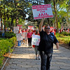 Marchers protesting the Brunswick, GA Glynn County Commission plan to expand the County Jail on waterfront view property and using eminent domain to do it.