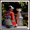 "Troy Brouwer of the Chicago Blackhawks with the Stanley Cup @ Sungod Arena in North Delta, BC.  He's riding on top of what is commonly called a ""Zamboni""  - an ice cleaning vehicle."