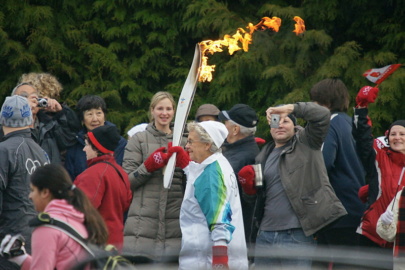 The 2010 Vancouver Winter Olympic Torch passing through North Delta.  I had hoped for some nice beauty shots but the torch was early and I was late so all I got was this one quick snapshot.