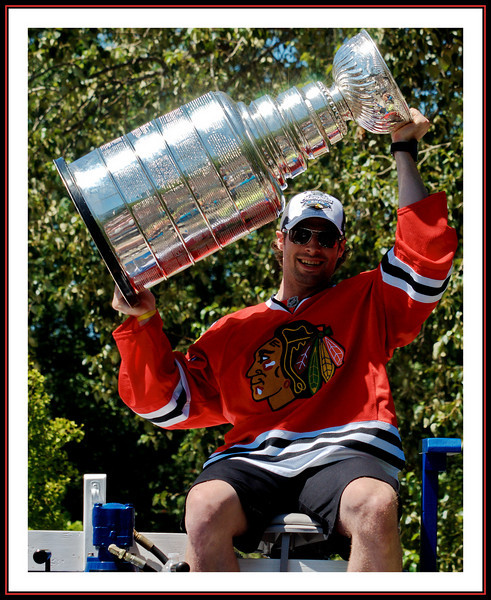 """Troy Brouwer of the Chicago Blackhawks with the Stanley Cup @ Sungod Arena in North Delta, BC.  He's riding on top of what is commonly called a """"Zamboni""""  - an ice cleaning vehicle."""