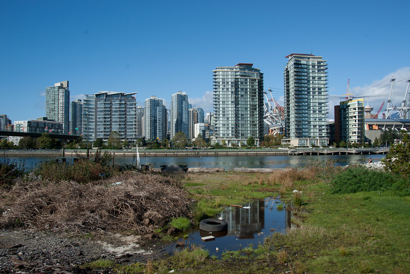 Some of the last remnants of the industrial wasteland in South False Creek, now awaiting redevelopment just west of the Olympic Village.  Yaletown and the BC Place stadium (with its new roof under construction) are in the background.  October 2010.
