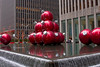 These oversized xmas tree ornaments can be found across the street from Radio City Music Hall.