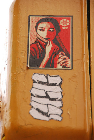 Shepard Fairey sticker on street light.