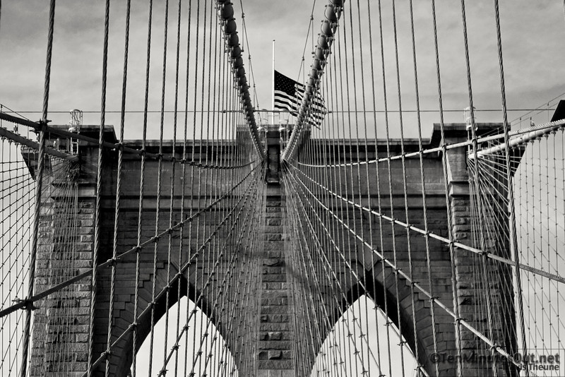 My favorite shot of the day. (Thanks for taking me across the bridge!)  In the original the sky was very flat and I wasn't all that impressed with it.  When I did the B&W conversion I was able to pull out some texture in the sky and tone down the brightness of the bridge.  I had to muddle the flag a little bit to get that over all look, but I think it was a worthy sacrifice.