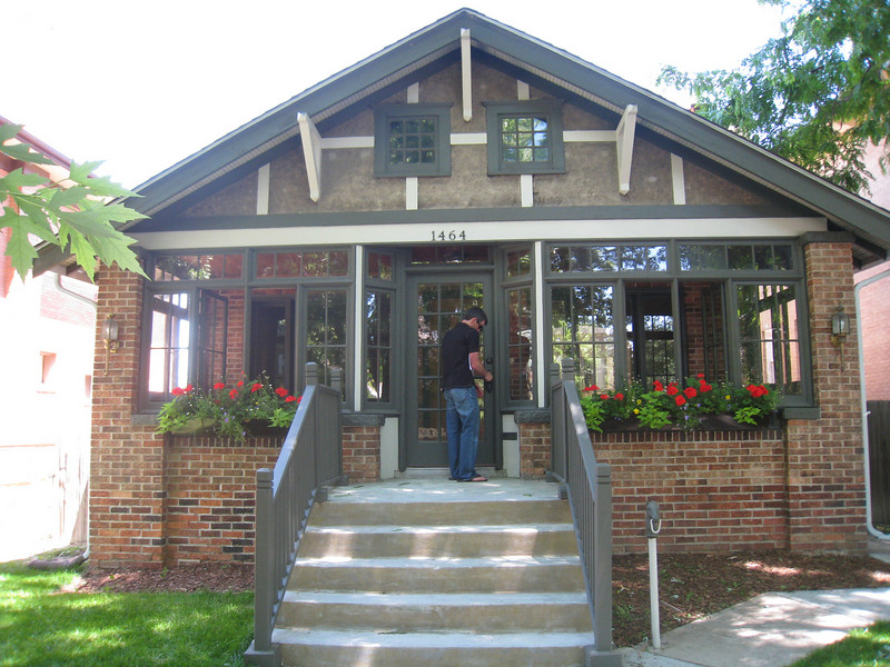 Front of the house with glassed in front porch...swinging framed windows in the front