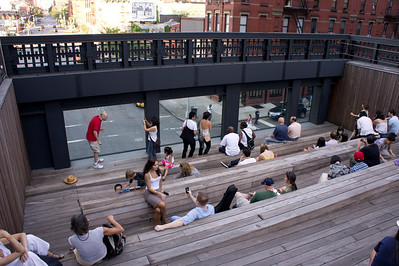 A small ampitheatre along the High Line provides a view of the street below.
