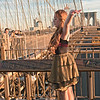 So there we are on the Brooklyn Bridge which was very cool.  One of the instructors is a world class photographer and shoots for Sports Illustrated and National Geographic is going to give us a flash demonstration.  This girl has been standing around unnoticed in a coat and she takes it off and steps forward, she's there as our model!  It was very interesting shooting a model because I'd never done that before.  The downside was a lot of people who were just walking by pushed us to the side to photograph her not knowing we were in a class and paid for her.  New Yorkers know how to push and shove their way to the front...