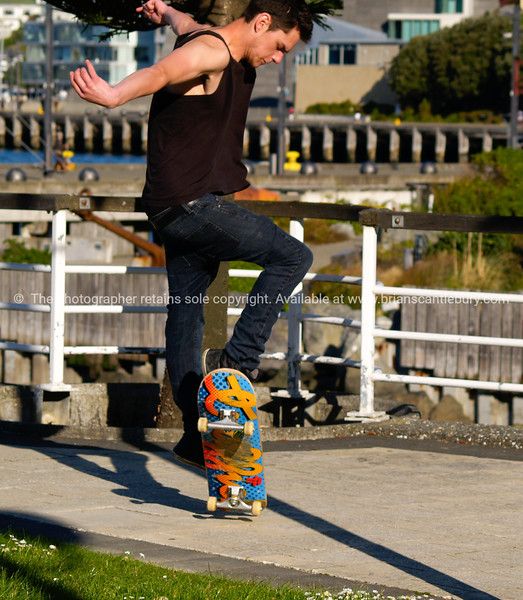 Skateboader on Wellington waterfront, October 2010.  Model released; no, for editorial & personal use.