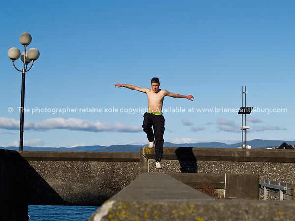 Building jumpers practicing on Wellingtons waterfront, New Zealand, 3rd October 2010.<br /> Athletic males.  Model released; no, for editorial & personal use.